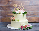 Fototapety two  layered wedding cream cheese cake with roses and eustoma
