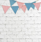 Party flags hanging on white brick wall background