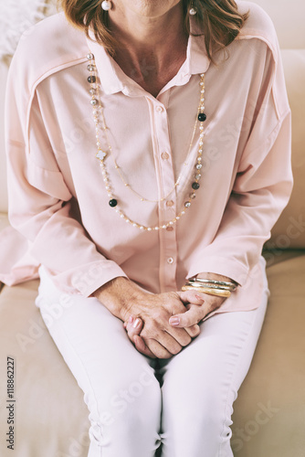 Cropped Image Of Woman Sitting On Sofa View From Above Buy