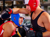 Close up of two sport men boxer wearing red and blue boxer helmet and boxer gloves boxing sport .