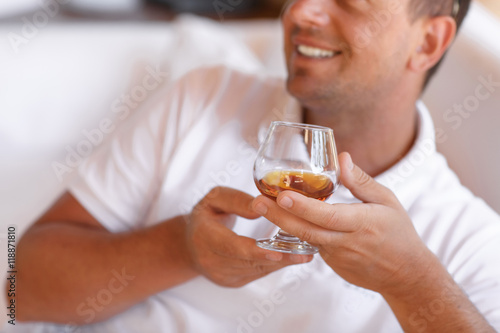 Rich handsome man drinking Whisky cognac at elite club summer Poster