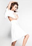 beautiful woman model posing in white dress in the studio - 118884059