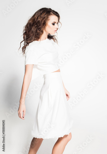 beautiful woman model posing in white dress in the studio Poster