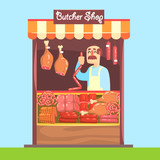 Butcher Behind Market Counter With Assortment Of Meat
