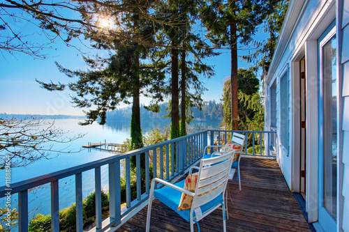 Fototapeta Walkout deck with chairs and amazing water view