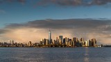 New York City Lower Manhattan cityscape time lapse video from afternoon to twilight. View of the Financial District skyscrapers, Midtown West and Ellis Island - 118892445