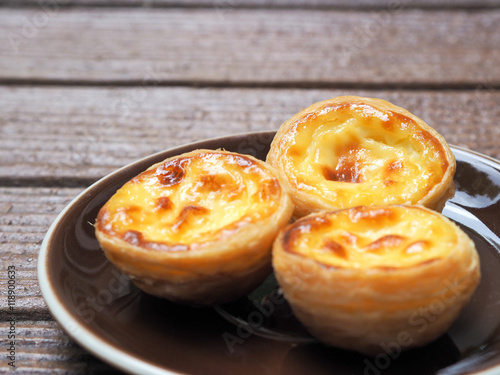 Poster Delicious Asian Egg tart from the Hong Kong famous shop on the brown plate for h
