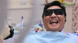 Dentist takes pictures with camera, patient sitting in a chair and smiling broadly.