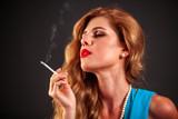 Portrait of girl who smokes cigarette. Smokes is bad habit.