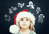Little Girl in Santa Hat dream on Gifts. Christmas Child