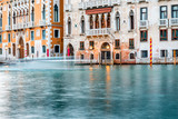 Beautiful waterfront with gothic buildings on Grand canal on the dusk in Venice