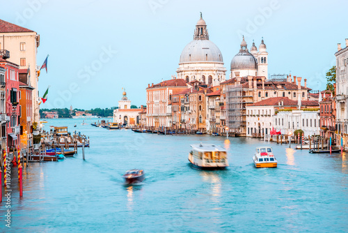 View on illuminated Grand canal with Santa Maria basilica from Accademic bridge at the dusk in Venice Poster