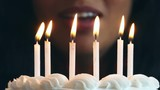 People lighting and blowing out candles on a cake...Shot in 4K on the Lumix FZ1000.