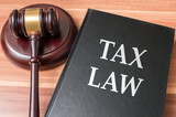 Book with tax laws. Justice and legislation concept.