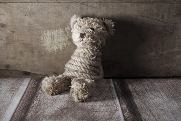 Tied teddy bear