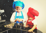 little boy and girl enjoy cooking in kitchen