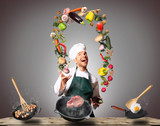 Chef juggling with vegetables and other food in the kitchen - 118983605