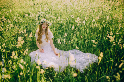 Young girl in a white dress in the meadow Poster
