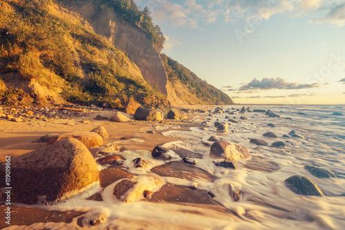 Zdjęcia na płótnie, fototapety na wymiar, obrazy na ścianę : Sea landscape at sunset, sandy beach and cliff,retro colors, vintage