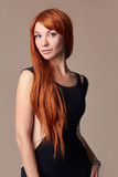 Elegant fashion photo of glamor beautiful young woman in dress posing in the studio,luxury.beauty red hair girl