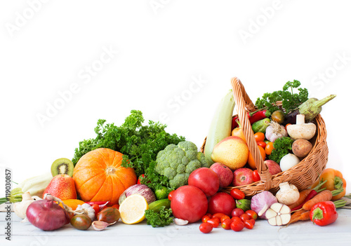 Composition with vegetables and fruits in wicker basket.