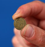 Fingers hold old coin from Bulgaria
