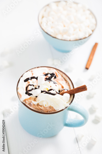 Foto op Canvas Chocolade hot chocolate with whipped cream and cinnamon
