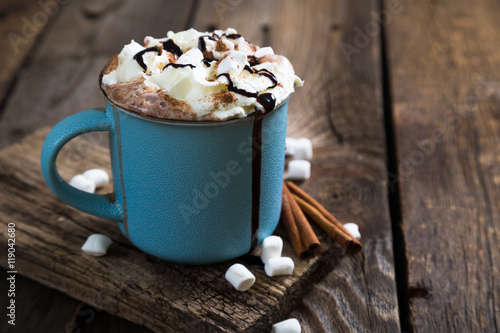 Fotobehang Chocolade hot chocolate with whipped cream and cinnamon
