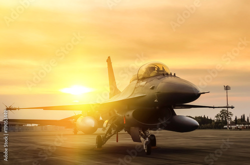 obraz PCV f16 falcon fighter jet parked on sunset background
