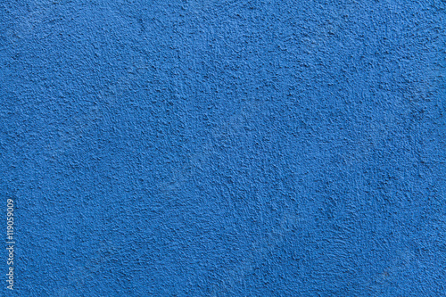 Blue painted stucco wall. Background texture