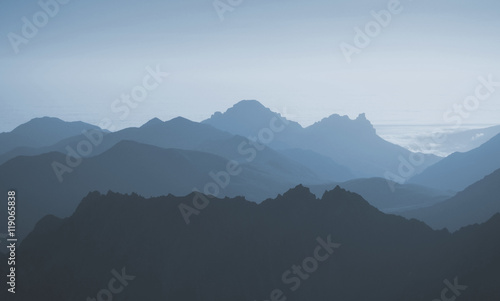 Fototapeta View of blue mountains abstract background. waves
