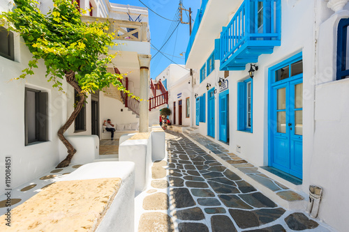 Narrow street with white houses in beautiful Mykonos town, Cyclades islands, Greece