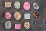 Fototapety sets of handmade ornamental soaps on black board, product of cosmetics or body care
