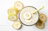 Fototapety Glass of banana smoothie
