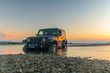 Постер, плакат: Jeep 4x4 against the sunset Jeep got stuck in the mud