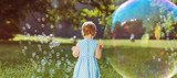 Cute little girl playing the soap bubbles - 119173660