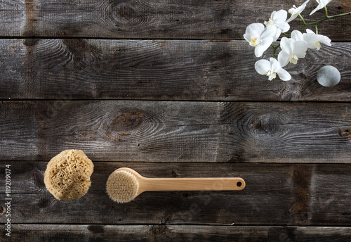 Fotobehang Spa rustic wood background with brush, natural sponge and white orchids