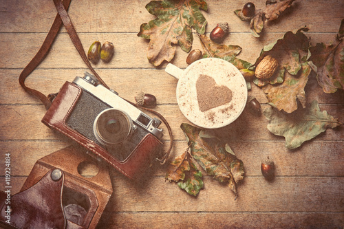 camera and cup of coffee Poster