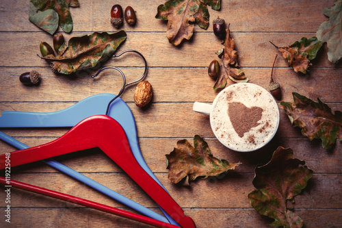 hangers, cup of coffee and fallen leaves Poster