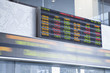 The currency exchange rates displayed at the Toronto Stock Exchange with stock ticker in blurred motion underneath.