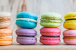 Macarons on table over wooden background