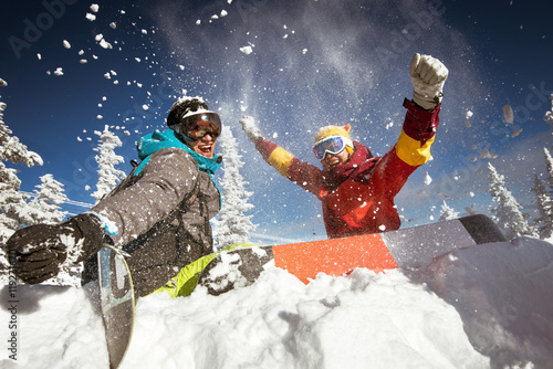 obraz lub plakat Couple of snowboarders having fun