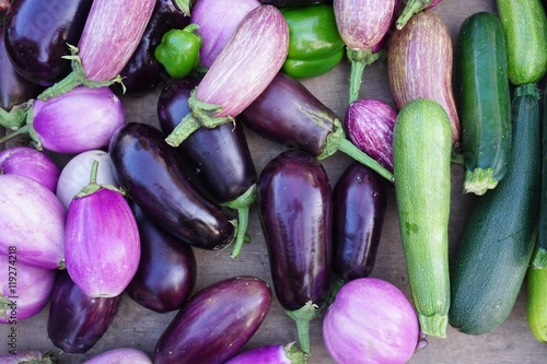 Purple eggplants and colorful summer vegetables