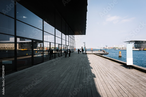 Copenhagen pier with wooden walkway and sea infrastructure at sunny day, Denmark
