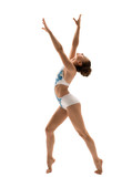Side view of graceful gymnast poses during workout