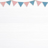 Colorful party flags hanging on blank white wood background