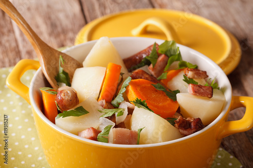 Poster Irish coddle with pork sausage, bacon and vegetables close-up