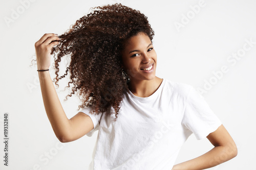 Poster black woman with afro hair touches her curly hair