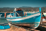 Old fishing boat on the land