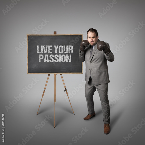Live your passion text on blackboard with businessman Poster